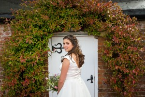 Bride Smiling Outside Door Entrance