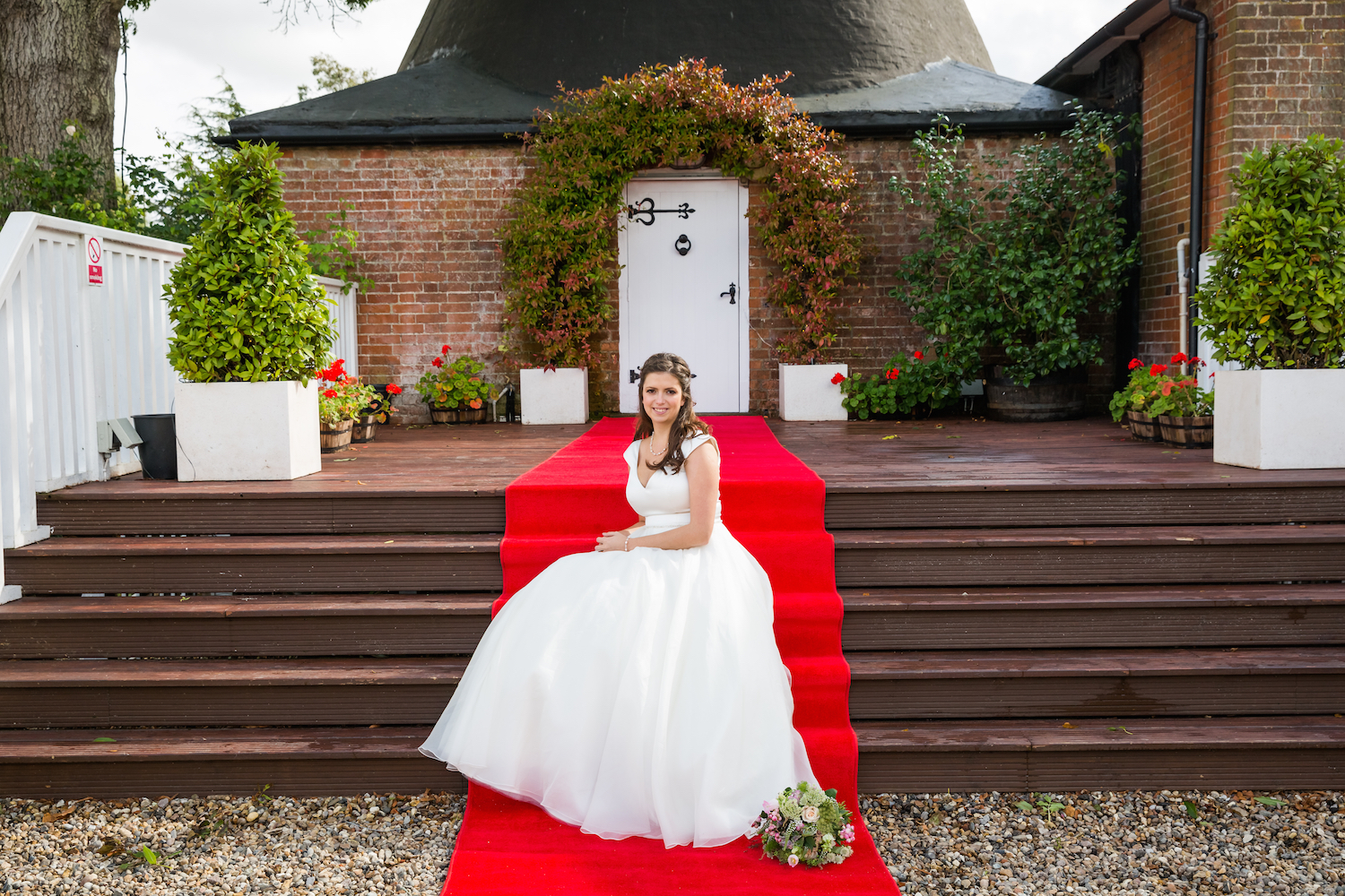 Bride on Red Carpet outside the Kiln Room